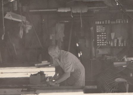 Ken Major working in the backyard shed in Netherby circa  1950s